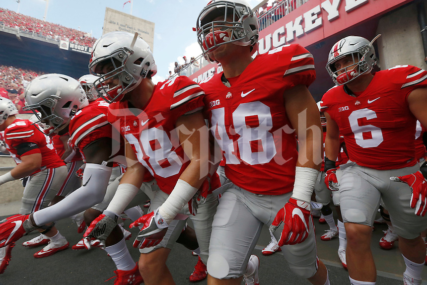 Ohio State players come out of the tunnel before the start of an NCAA football game between the Ohio State Buckeyes and the Tulsa Golden Hurricane at Ohio Stadium on Saturday, September 10, 2016. (Columbus Dispatch photo by Fred Squillante)