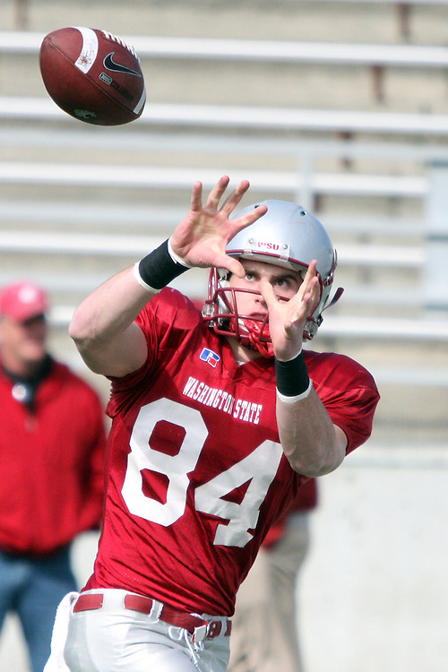 Jared Karstetter, Washington State wide receiver, locks in on a pass during a spring practice scrimmage at Martin Stadium on the campus of Washington State University in Pullman, Washington, on April 25, 2009.