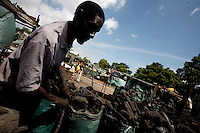 a somali packs coal in the dangerous Affissione market in Mogadishu, Somalia on Saturday Dec 30 2006.. Only a few days after the fall of the United Islamic Courts in Mogadishu, Ethiopian and Transitional Federal Government troops are patrolling the city and securing strategic locations..The people in Mogadishu appear confused and doubtful on t