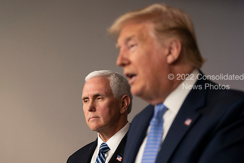 United States Vice President Mike Pence listens as US President Donald J. Trump makes a statement on coronavirus during a news briefing at the White House in Washington, DC on March 15, 2020. <br /> Credit: Chris Kleponis / Pool via CNP