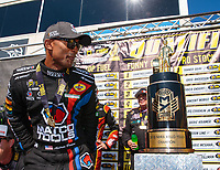 Sep 16, 2018; Mohnton, PA, USA; NHRA top fuel driver Antron Brown next to the championship trophy during the Dodge Nationals at Maple Grove Raceway. Mandatory Credit: Mark J. Rebilas-USA TODAY Sports