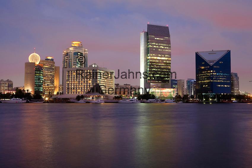 United Arab Emirates, Dubai: View over the Dubai Creek with the National Bank of Dubai building, the Sheraton Dubai Hotel and Dubai at dusk