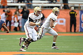 Boston College Eagles offensive lineman Matt Patchan (77) and tight end Jake Sinkovec (41) block during a game against the Syracuse Orange at the Carrier Dome on November 30, 2013 in Syracuse, New York.  Syracuse defeated Boston College 34-31.  (Copyright Mike Janes Photography)