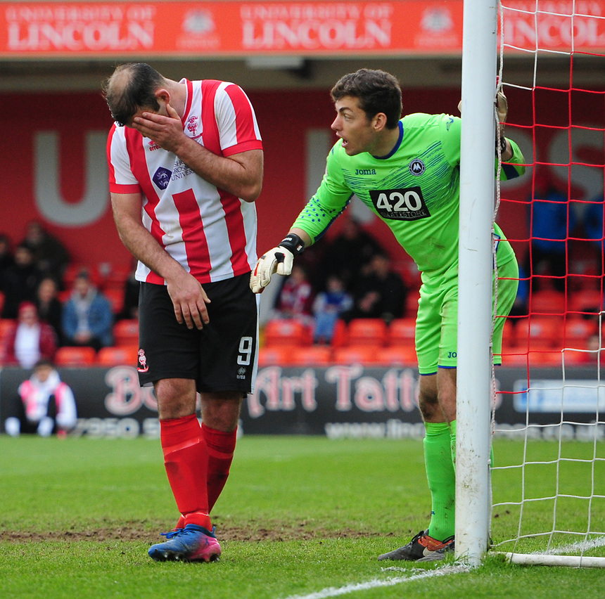 Lincoln City's Matt Rhead claims to have been caught in the face by Torquay United's Brendan Moore<br /> <br /> Photographer Chris Vaughan/CameraSport<br /> <br /> Vanarama National League - Lincoln City v Torquay United - Friday 14th April 2016  - Sincil Bank - Lincoln<br /> <br /> World Copyright &copy; 2017 CameraSport. All rights reserved. 43 Linden Ave. Countesthorpe. Leicester. England. LE8 5PG - Tel: +44 (0) 116 277 4147 - admin@camerasport.com - www.camerasport.com