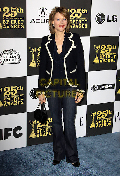 JODIE FOSTER .25th Annual Film Independent Spirit Awards held At The Nokia LA Live, Los Angeles, California, USA,.March 5th, 2010 ..arrivals Indie Spirit  full length navy  blue blazer jacket white trim ruffle shirt top blouse jeans denim  bag .CAP/ADM/KB.©Kevan Brooks/Admedia/Capital Pictures