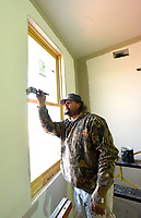 NWA Democrat-Gazette/FLIP PUTTHOFF<br />FIRE STATION PAINTING<br />Ed Isam, with M&amp;L Painting in Bella Vista, paints Wednesday Feb. 7 2018 around windows at a new Lowell fire station under construction on Bellview Road north of Monroe Avenue. Mike Morris, chief of the Lowell Fire Department, said it is the second station for the department. It will decrease response times to the west side of Lowell by 50 percent, he said. The station should be finished in mid March and be put in service late May or early June.