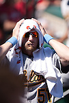 June 20, 2010       Oakland Athletics pitcher Dallas Braden (51) draped a towel over his head to keep the sun off and try to stay cool in the full sun and hot temperatures of the day game against the Cardinals.  The St. Louis Cardinals lost 3-2 to the Oakland Athletics in the final game of a three-game homestand at Busch Stadium in downtown St. Louis, MO on Sunday June 20, 2010.