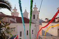 Colourful fiesta streamers near a church in Alfama, the oldest district in the city and the original Moorish area, Lisbon, Portugal. Picture by Manuel Cohen