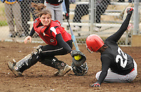 Bellingham catcher Courtney Farlow reaches to tag Mount Baker's Danielle Leech as Leech slides home during the second inning at Frank Geri Fields on Tuesday, March 24, 2009.