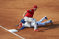 Nolan Gorman (4) of the Johnson City Cardinals applies the tag as Rafael Romero (8) of the Burlington Royals slides into third base at Burlington Athletic Stadium on July 15, 2018 in Burlington, North Carolina. The Cardinals defeated the Royals 7-6.  (Brian Westerholt/Four Seam Images)