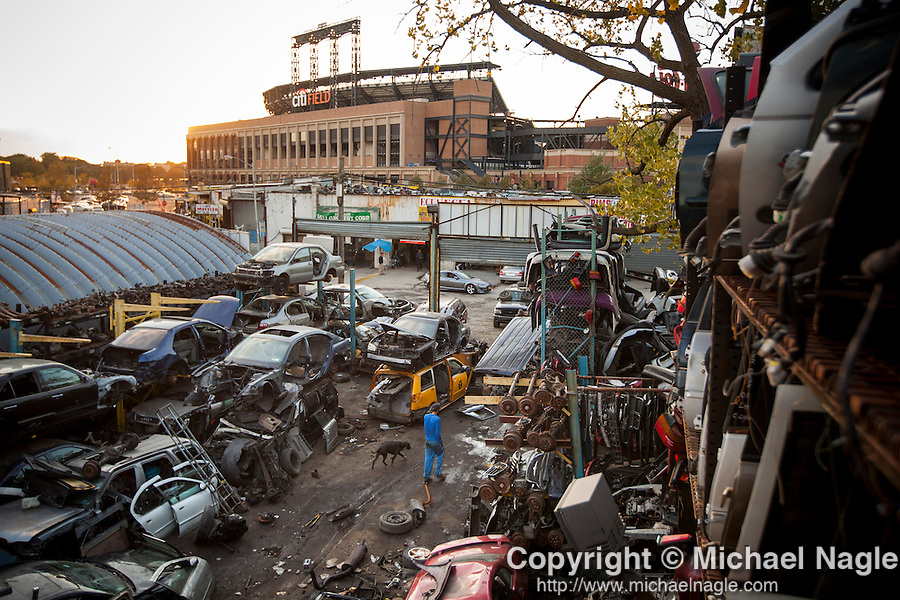 QUEENS, NY -- OCTOBER 22, 2013:  Yoniwalks with his dog through ACDC Scrap Metal Inc., climb to the top of their storage in Willets Point on October 22, 2013 in Queens.  Photographer: Michael Nagle for The New York Times