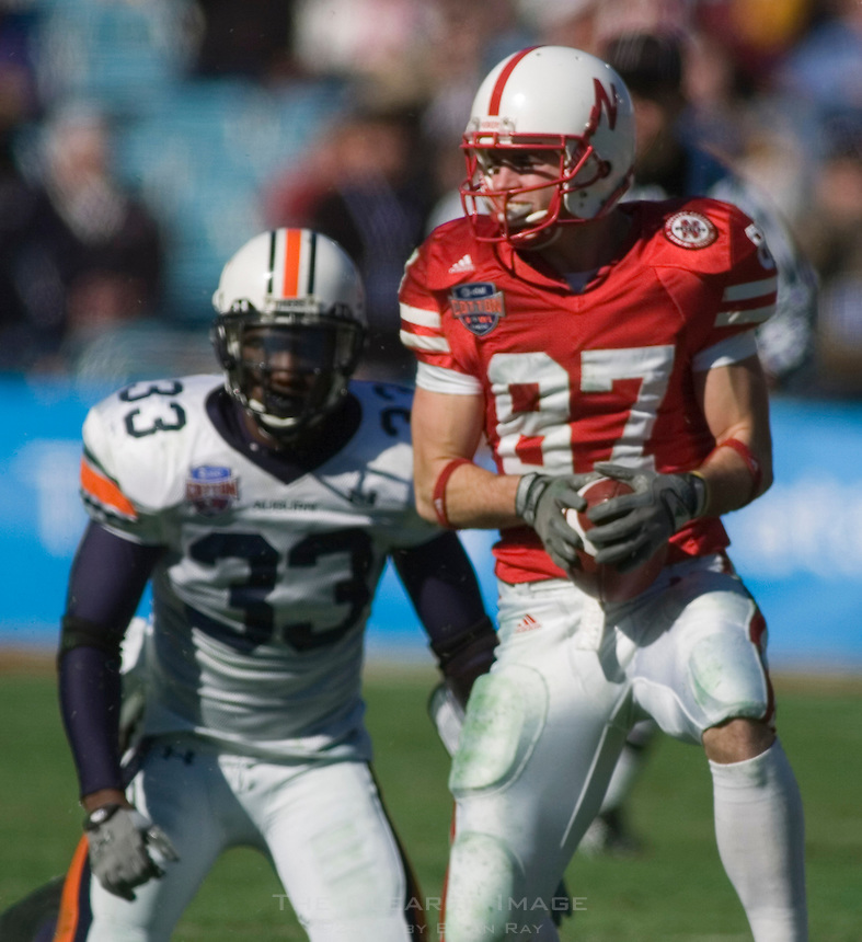 01 January 2007: Nebraska receiver Nate Swift (#87) runs with the ball after a catch during the 2007 AT&T Cotton Bowl Classic between The University of Auburn and The University of Nebraska at The Cotton Bowl in Dallas, TX.