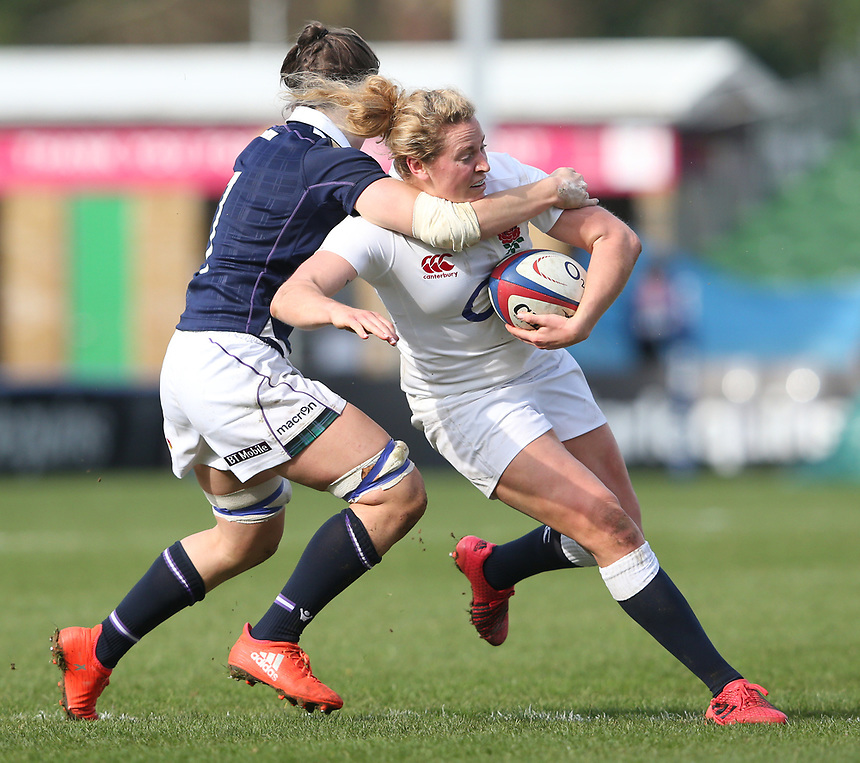England Women's Amber Reed is tackled by Scotland Women's Louise McMillan<br /> <br /> Photographer Stephen White/CameraSport<br /> <br /> Women's Six Nations Round 4 - England Women v Scotland Women - Saturday 11th March 2017 - The Stoop - London<br /> <br /> World Copyright &copy; 2017 CameraSport. All rights reserved. 43 Linden Ave. Countesthorpe. Leicester. England. LE8 5PG - Tel: +44 (0) 116 277 4147 - admin@camerasport.com - www.camerasport.com