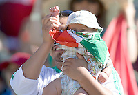 05 July 2009: Mexico soccer fan shows off his baby wrapped Mexico flag during the game between Mexico and Nicaragua at Oakland-Alameda County Coliseum in Oakland, California.    Mexico defeated Nicaragua, 2-0.