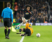 4th January 2020; Molineux Stadium, Wolverhampton, West Midlands, England; English FA Cup Football, Wolverhampton Wanderers versus Manchester United; Maximilian Kilman of Wolverhampton Wanderers fouls Tahith Chong of Manchester United with a sliding tackle on the side line - Strictly Editorial Use Only. No use with unauthorized audio, video, data, fixture lists, club/league logos or 'live' services. Online in-match use limited to 120 images, no video emulation. No use in betting, games or single club/league/player publications