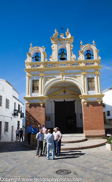 Men gather by the baroque church of San Juan at Zahara de la Sierra, Spain Sunday 13 October 2013 after the National Day holiday