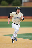 Jonathan Pryor (11) of the Wake Forest Demon Deacons hustles towards third base against the Harvard Crimson at David F. Couch Ballpark on March 5, 2016 in Winston-Salem, North Carolina.  The Crimson defeated the Demon Deacons 6-3.  (Brian Westerholt/Four Seam Images)
