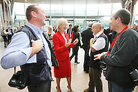 7/9/2010. Convention Centre opens. Mary Hanifin TD is pictured speaking with press photographers Robbie Reynolds, Frank Mc Grath and Declan Masterson at the official opening of the Dublin Convention Centre. Picture James Horan/Collins