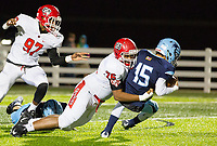 Northside vs Springdale Har-ber 7A Playoffs - Blaise Wittschen (15) of Springdale Har-ber is sacked by Stevie Young (76) of Northside at Wildcat Stadium, Springdale, AR on Friday, November 10, 2017  Special to NWA Democrat-Gazette/ David Beach