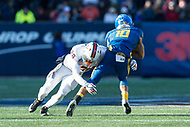 Annapolis, MD - DEC 28, 2017: Virginia Cavaliers safety Brenton Nelson (28) tackles Navy Midshipmen Quarterback Malcolm Perry (10) during game between Virginia and Navy at the Military Bowl presented by Northrop Grunman at Navy-Marine Corps Memorial Stadium Annapolis, MD. (Photo by Phil Peters/Media Images International)