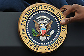 The Presidential seal is placed on the podium before United States President Barack Obama delivered remarks on passage of sweeping financial reform legislation, at the South Lawn of the White House in Washington DC, USA, Thursday, 15 July 2010.  The US Senate passed the Restoring American Financial Stability Act of 2010, 15 July 2010, which is aimed at reforming Wall Street.  .Credit: Michael Reynolds - Pool via CNP