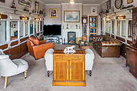 BNPS.co.uk (01202 558833)<br /> Pic: PurpleBricks/BNPS<br /> <br /> A rail enthusiasts dream home... the living room flanked by the two carriages. <br /> <br /> This £475,000 seaside cottage contains a charming secret – it's built around two Victorian railway carriages.<br /> <br /> The 19th century carriages were used as temporary housing for soldiers returning from the First World War when there was a shortage of homes.<br /> <br /> But many of them remained in place years later and had bricks and mortar built around them.<br /> <br /> And so from the street view they looked like normal houses but inside the main reception rooms were with the converted carriages.