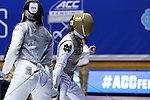 DURHAM, NC - FEBRUARY 25: Duke's Lee Kiefer (right) reacts after scoring a point against Duke's Julia Lee (left) during their Women's Foil semifinal match. The Atlantic Coast Conference Fencing Championships were held on February, 25, 2017, at Cameron Indoor Stadium in Durham, NC.
