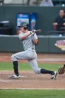 Logan Moon (12) of the Wilmington Blue Rocks follows through on his swing against the Winston-Salem Dash at BB&T Ballpark on June 10, 2015 in Winston-Salem, North Carolina.  The Blue Rocks defeated the Dash 11-5.  (Brian Westerholt/Four Seam Images)