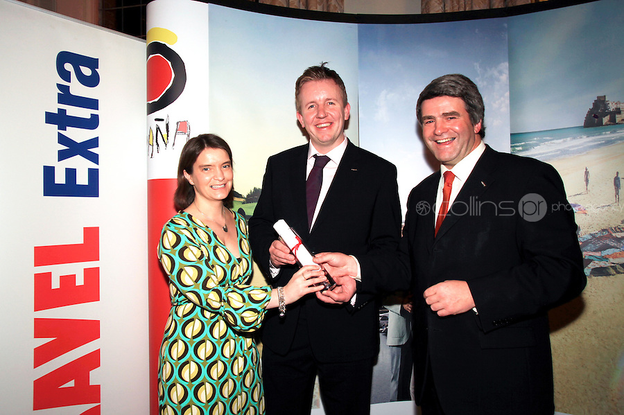 NO REPRO FEE: 27.1.12: Travel Extra Travel Journalist of the Year Awards Announced In Dublin. Pictured was Orla Carroll from Failte Ireland and Eoghan Corry, Editor of Travel Extra presenting 'home market' category winner to Ed Leahy (centred) from RTE Travel. Picture Collins Photos.