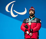 PyeongChang 10/3/2018 - Collin Cameron collects his bronze medal in the men's biathlon 7.5km sitting during the medal ceremony at the PyeongChang Olympic Plaza during the 2018 Winter Paralympic Games in Pyeongchang, Korea. Photo: Dave Holland/Canadian Paralympic Committee