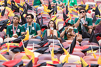 MOSCOW, RUSSIA - June 17, 2018: Mexico fans eat some food while waiting for the start of their game against Germany in their 2018 FIFA World Cup group stage match at Luzhniki Stadium.