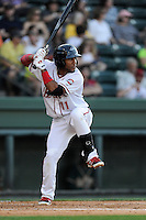 Second baseman Wendell Rijo (11) of the Greenville Drive bats in a game against the Greensboro Grasshoppers on Wednesday, May 7, 2014, at Fluor Field at the West End in Greenville, South Carolina. Rijo is the No. 18 prospect of the Boston Red Sox, according to Baseball America. Greenville won, 12-8. (Tom Priddy/Four Seam Images)