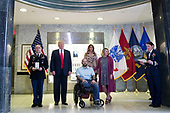 US President Donald J. Trump (2-L), with First Lady Melania Trump (3-R), listen as a citation is read for Sergeant First Class Alvaro Barrientos (3-L), with his wife Tammy Barrientos (2-R), during a Purple Heart ceremony at Walter Reed National Military Medical Center in Bethesda, Maryland, USA, 22 April 2017. Sergeant First Class Alvaro Barrientos was recently injured in Afghanistan while deployed and for the wounds he sustained, he is receiving the Purple Heart.<br /> Credit: Shawn Thew / Pool via CNP