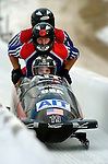 20 November 2005: Mike Kohn, pilot of the USA 2 sled, crosses the finish line for a 7th place finish at the 2005 FIBT AIT World Cup Men's 4-Man Bobsleigh Tour at the Verizon Sports Complex, in Lake Placid, NY. Mandatory Photo Credit: Ed Wolfstein.