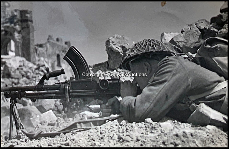 BNPS.co.uk (01202 558833)<br /> Pic:  ChiswickAuctions/BNPS<br /> <br /> An allied gunner during the attack on Monte Cassino.<br /> <br /> Remarkable previously unseen photos documenting the momentous closing stages of World War Two and its historic aftermath have come to light.<br /> <br /> They were taken by Sergeant Charles Hewitt, of the Army Film and Photographic Unit, who later went on to work for the Picture Post and the BBC.<br /> <br /> He was present at many of the important offensives of 1944 and '45 including the Battle of Monte Cassino during the Italian Campaign and the Allies advance into Germany following the D-Day invasion.