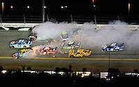 Feb 07, 2009; Daytona Beach, FL, USA; NASCAR Sprint Cup Series driver A.J. Allmendinger (44) drives through the middle as Kyle Busch (18), Denny Hamlin (11), Kasey Kahne (9), Jimmie Johnson (48) crash during the Bud Shootout at Daytona International Speedway. Mandatory Credit: Mark J. Rebilas-