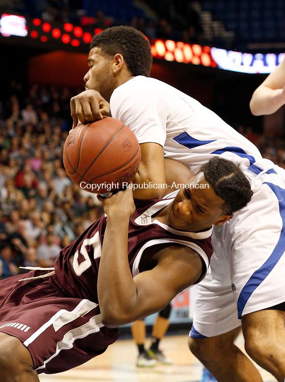 Uncasville, CT- 22 March 2015-032215CM05- Naugatuck's Fejiro Onakpoma is fouled by Bunnell's Donte' Peeler during their first half matchup in the Class L state championship game at Mohegan Sun Arena in Uncasville on Sunday.    Christopher Massa Republican-American