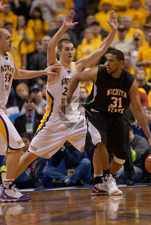 March 7,  2010           Wichita State forward/center J.T. Durley (31) dribbles and looks for a way in to the basket in the second half as he's guarded by Northern Iowa forward Jake Koch (20, center) and at far left Northern Iowa center Jordan Eglseder (53).  The University of Northern Iowa defeated Wichita State 67-52 on Sunday March 7, 2010 in the championship game of the Missouri Valley Conference Tournament at the Scottrade Center in downtown St. Louis.   They automatically earn a berth in the NCAA Tournament.