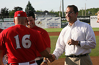 June 19, 2009:  Manager Mark DeJohn is congratulated by Cardinals General Manager John Mozeliak during a ceremony to award the 2008 NY-Penn League Champions before a game at Dwyer Stadium in Batavia, NY.  The Batavia Muckdogs are the NY-Penn League Short Season Class-A affiliate of the St. Louis Cardinals.  Photo by:  Mike Janes/Four Seam Images