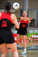 Christchurch's Charlotte Elley in action during the 2015 National Netball Championship match between Auckland (blue) and Christchurch (red and black) at ASB Sports Centre, Kilbirnie, Wellington, New Zealand on Tuesday, 29 September 2015. Photo: Dave Lintott / lintottphoto.co.nz