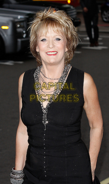 SHERRIE HEWSON.Arrivals for the Harper's Bazaar Women of The Year Awards at the Dorchester Hotel, Park Lane, London, England, September 7th 2009.half length black sleeveless dress silver necklaces .CAP/FEE.©FEE/Capital Pictures.