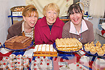 CAKES & CRAFTS: Natalie Thornton, Pat Parrish and Jackie Stanley displaying their homemade cakes at the Kingdom County Fair on Sunday.