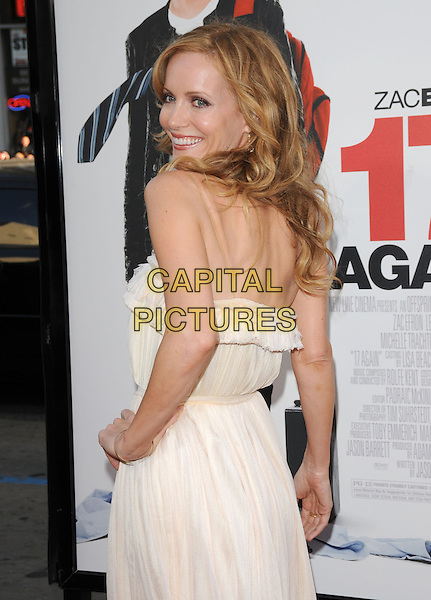 "LESLIE MANN .The L.A. premiere of ""17 Again"" held at The Grauman's Chinese Theatre in Hollywood, California, USA. .April 14th, 2009.half length white cream dress hand on hip ruffle looking over shoulder .CAP/DVS.©Debbie VanStory/Capital Pictures."