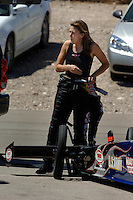 Apr 8, 2006; Las Vegas, NV, USA; NHRA Top Fuel driver Melanie Troxel, driver of the Skull Gear/Torco Race Fuels dragster following a qualifying run for the SummitRacing.com Nationals at Las Vegas Motor Speedway in Las Vegas, NV. Mandatory Credit: Mark J. Rebilas
