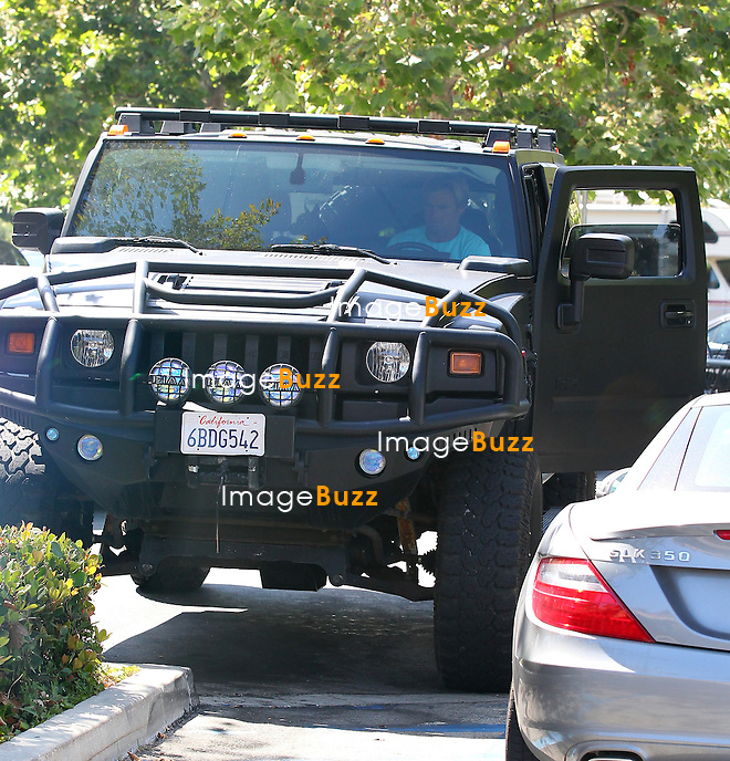 Laird Hamilton ( big-wave-surfer ) at the Vitamin Bar in Malibu, driving away in his Lifted blacked-out Hummer. Los Angeles, June 22, 2012..Exclusive photos..