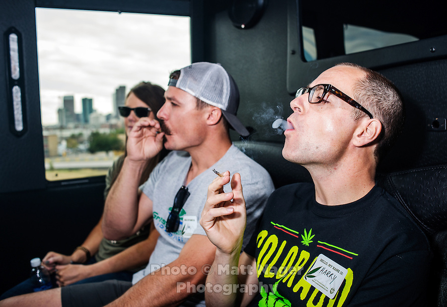 Reporter Harry Wallop smokes a joint with Jon Grant (left) and Niki Grant (far left) on a Colorado Cannabis Tour for a marijuana tour to Medicine Man grow facility in Denver, Colorado, Friday, September 30, 2016. <br /> <br /> Photo by Matt Nager