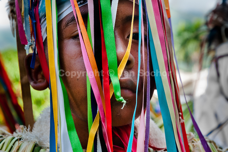 "A Cucambas dancer takes part in the religious procession in Atanquez, Sierra Nevada, Colombia, 3 June 2010. A colorful celebration of Corpus Christi is held in the Kankuamo Indians territory every year. ""The Dance of the Devils"" is an ancient tradition kept for centuries on the Colombia's Caribbean coast. This Christian religious event usually coincides with the summer solstice, which has always been the key point for the native cultures and for the black African slaves. Due to this confluence, the Kankuamo myths, the African animistic rites and other Pre-Columbian features have blended with the Spanish Catholic festival into a lively spectacle."