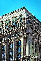 New York: 90 West St., 1905-07, a sort of warm-up for The Woolworth. Cass Gilbert, Architect. Complexity not for the pedestrian, but for ships in the river and office dwellers nearby. Photo '91. (Note: Damaged in WTC disaster. More info: http://www.nyc-architecture.com/LM/LM076.htm)
