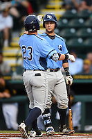 Charlotte Stone Crabs catcher Maxx Tissenbaum (8) fist bumps Jake Bauers (23) after a home run during a game against the Bradenton Marauders on April 20, 2015 at McKechnie Field in Bradenton, Florida.  Charlotte defeated Bradenton 6-2.  (Mike Janes/Four Seam Images)