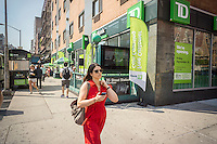 TD Bank sponsored festivities at the grand opening of a new branch in the Chelsea neighborhood of New York on Friday, September 18, 2015. TD Bank has seen growth recently through expansion of its retail banking network and the acquisition of other banks. (© Richard B. Levine)